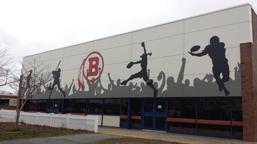 Barnstable high school recreation center with custom digitally printed HPL panels
