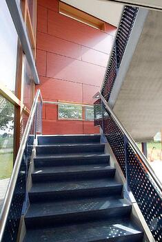 School stairwell with red Fundermax phenolic panels