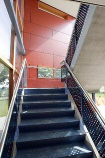 Examples of High-Traffic Spaces Where HPL Cladding Thrives - School Stairwell