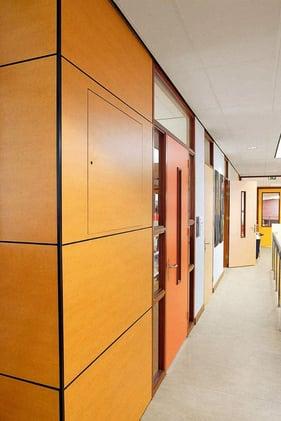 School hallway with woodgrain Fundermax phenolic panels