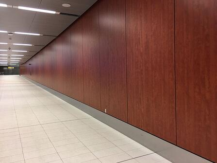 Examples of High-Traffic Spaces Where HPL Cladding Thrives - Airport Hallway