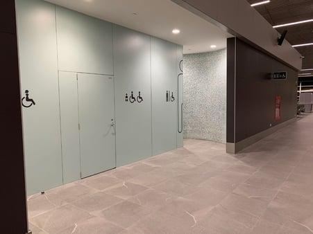 Digitally printed wall panels to indicate bathrooms at an airport