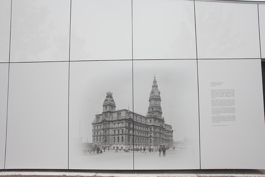Historical information for a city digitally printed on the side of a building with Fundermax panels