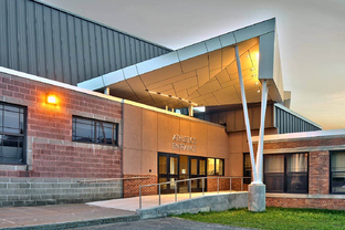 The other side of the building with a mirrored entryway to the athletics area of Sodus High School
