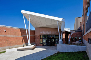 Entryway into Sodus High School with white Fundermax phenolic panels