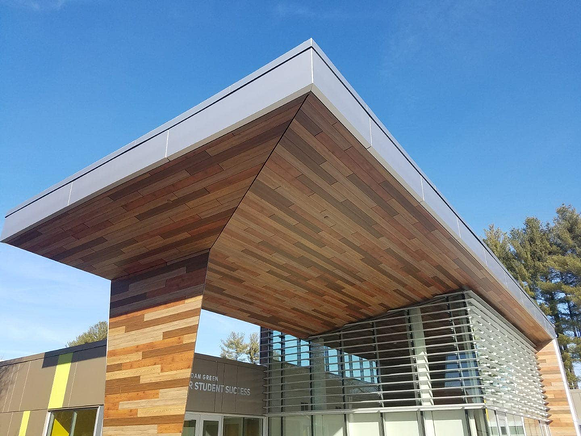 South New Hampshire University library using exterior panels and a Fundermax Modulo fastening system.