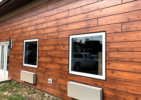 Webster New York nursing home using Fundermax exterior panels in a woodgrain and a Scaleo Lap Siding fastening system
