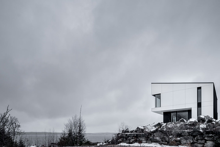 Residential home in Canada using white exterior phenolic panels and a concealed fastener.