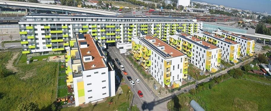 Residential building in Austria utilizing FunderMax's exterior phenolic panels for their balconies.