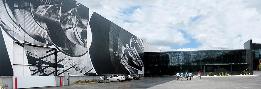 Indar Electric Company's large digitally printed phenolic panels from Fundermax on the exterior of their office building