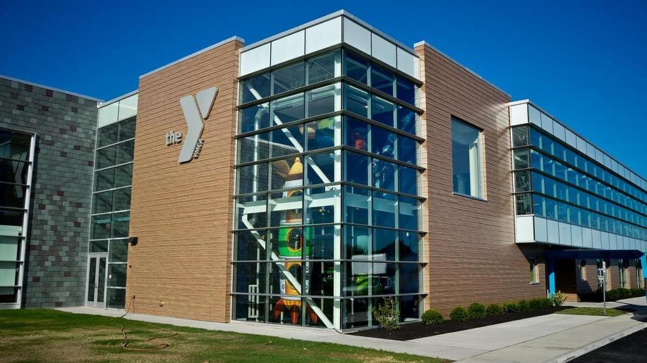 Lockport YMCA using a woodgrain Fundermax phenolic panel in a high-traffic, exterior area.