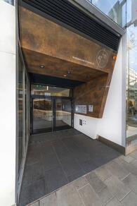 Examples of High-Traffic Spaces Where HPL Cladding Thrives - Workplace cohesive design