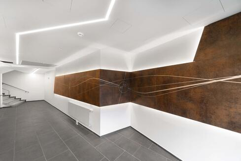 Custom digitally printed hallway wall lining panels in a woodgrain with with added branding and imagery