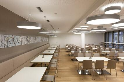 Examples of High-Traffic Spaces Where HPL Cladding Thrives - Office cafeteria