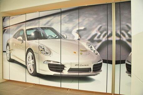 Custom bathroom partition with an image of a porche