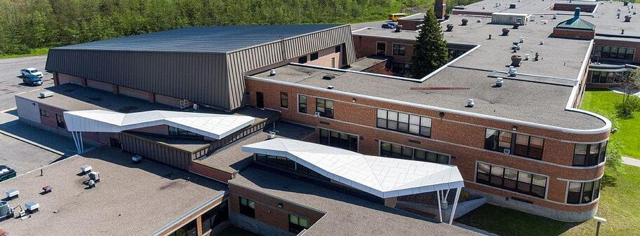High view of the finished application on Sodus High School using Fundermax in a unique roofing application for added protection.