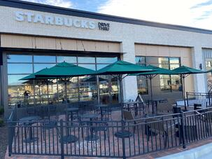 Starbucks in North Carolina with exterior phenolic panels in a shopping center and a exposed fastener.