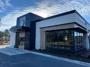 Starbucks in North Carolina with exterior phenolic panels in a woodgrain and a exposed fastener.