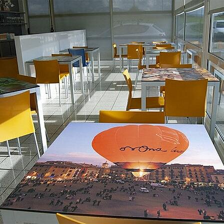 Digitally printed HPL panel with a hot air balloon as a table top in a restaurant
