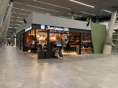 Examples of High-Traffic Spaces Where HPL Cladding Thrives - Airport Food Court