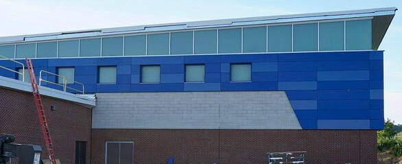 Victor central school exterior phenolic panel installation  and a exposed fastener.